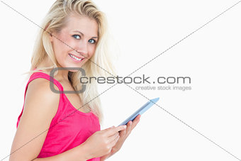 Portrait of happy casual woman with digital tablet