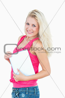 Portrait of happy casual young woman with digital tablet