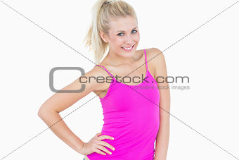 Portrait of casual woman with hand on hip