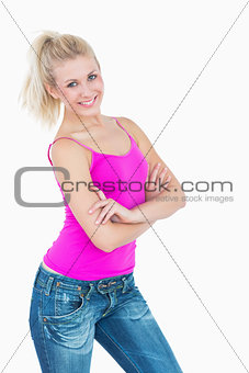 Portrait of happy casual woman with arms crossed