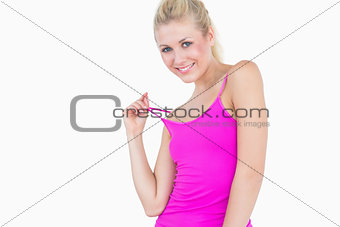 Portrait of happy casual young woman posing