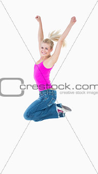 Portrait of an excited casual woman jumping in air