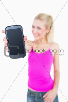 Portrait of casual young woman showing you her new smartphone