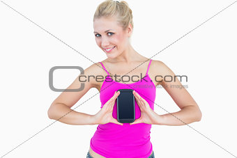 Portrait of casual young woman with new smartphone