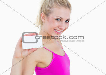 Portrait of beautiful woman holding blank card
