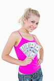 Portrait of happy woman holding fanned us banknotes
