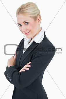 Portrait of confident young business woman standing with arms crossed