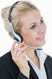 Closeup portrait of young business woman wearing headset