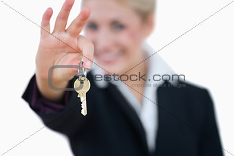 Business woman holding out key