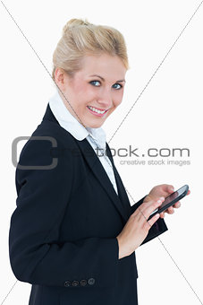 Portrait of young business woman using smartphone