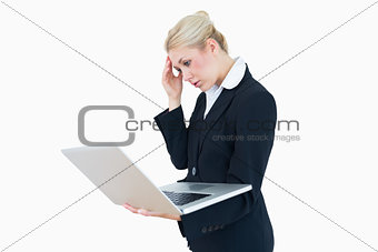 Worried businesswoman on laptop