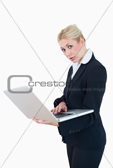 Portrait of young businesswoman using laptop