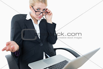 Portrait of young businesswoman with laptop