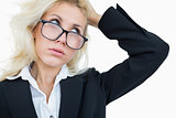 Closeup of frustrated business woman scratching head