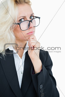 Portrait of thoughtful business woman with hand on chin