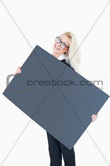 Portrait of happy business woman holding blank board