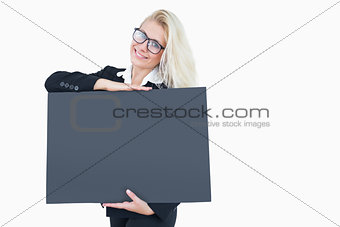 Portrait of happy young business woman holding blank board