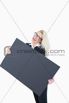 Portrait of cheerful business woman holding empty banner