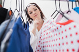 Woman selecting clothing