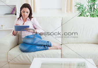 Casual woman using digital tablet at home