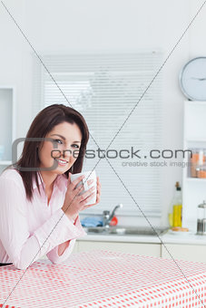 Portrait of happy young woman with coffee cup