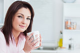 Closeup portrait of woman with coffee cup