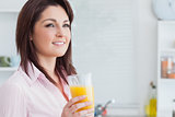 Closeup of smiling woman with orange juice