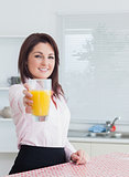 Smiling woman giving you orange juice