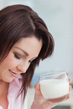 Young woman with glass of milk