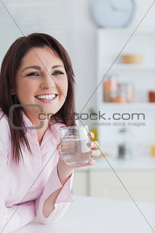 Portrait of young woman with glass of water