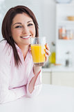 Closeup of young woman with orange juice