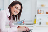 Portrait of smiling woman using laptop