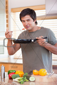 Man cooking food in the kitchen