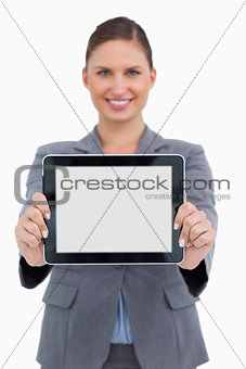 Smiling business woman holding digital tablet