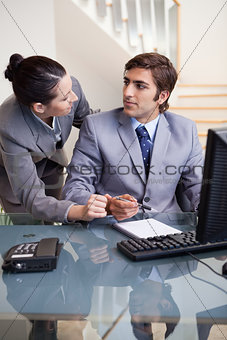 Business colleagues looking at each other at office
