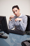 Business woman sitting in front of desktop computer