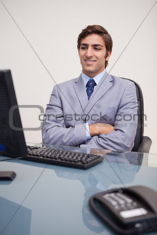 Business man sitting in front of desktop computer