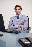 Portrait of business man sitting in front of desktop computer