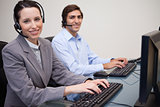 Happy call center employees at work