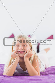 Little girl lying on a bed