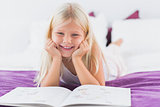 Little girl reding her lesson