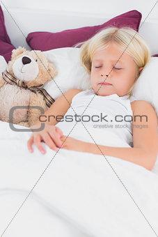 Little girl sleeping near to her teddy bear