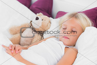 Cute girl sleeping near to her teddy bear