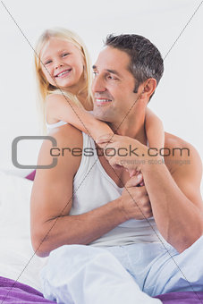 Father and his daughter doing piggyback