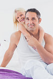 Smiling father and his daughter doing piggyback