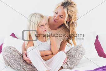 Mother and her daughter talking