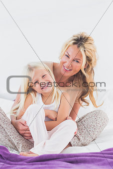 Mother and her daughter looking at camera