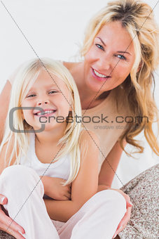 Mother and child sitting on a bed