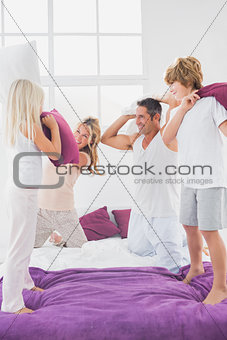 Family having fun with pillows