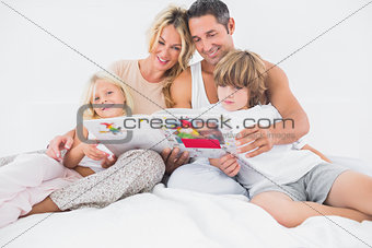Smiling family reading a story together